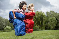 Two boys (7-9) racing in sleeping bags