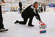 Barry Ivy of Livermore delivers during the San Francisco Bay Area Curling Club's Tuesday night league at Sharks Ice in San Jose on Jan.15, 2013.