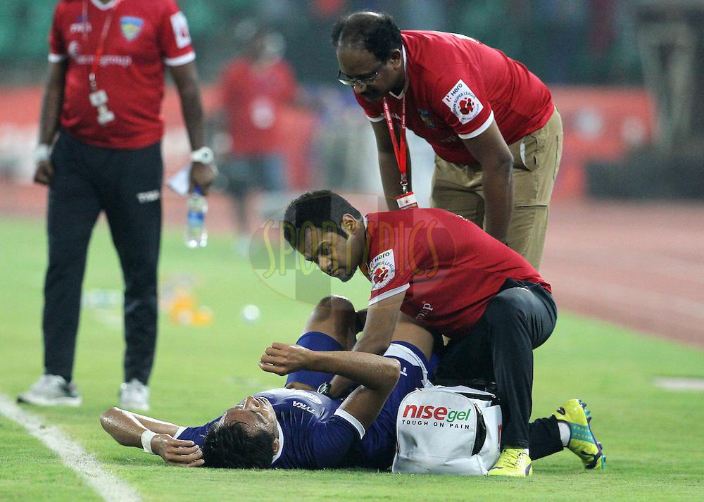 Gouramangi Singh of Chennaiyin FC gets medical assistance during match 36 of the Hero Indian Super League between Chennaiyin FC and FC Pune City held at the Jawaharlal Nehru Stadium, Chennai, India on the 19th November 2014.<br /> <br /> Photo by:  Vipin Pawar/ ISL/ SPORTZPICS