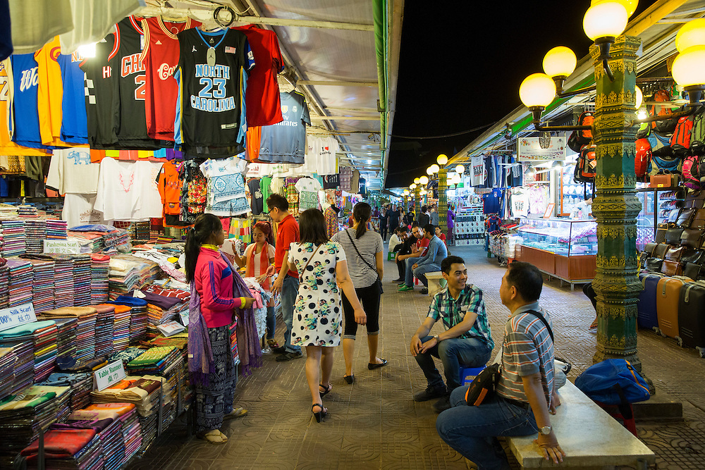 Shoppers look around and market sellers sit on benches inside the Siem Reap Art Centre Night Market in Siem Reap, Cambodia, Asia. This market was opened in 2012.(photo by Andrew Aitchison / In pictures via Getty Images)