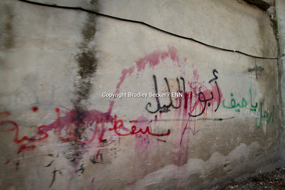 Anti regime graffiti on a wall in the town of Al Janoudiyah, Idlib province, Syria