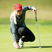 26 March 2018: Georgia Lacey repositions her ball on the eight green during the opening round of the March Mayhem Tournament hosted by SDSU at the Farms Golf Club in Rancho Santa Fe, California. <br /> More game action at sdsuaztecphotos.com