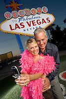 Middle-aged couple in front of Welcome to Las Vegas sign