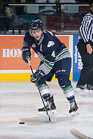 KELOWNA, CANADA - APRIL 3: Adam Henry #4 of the Seattle Thunderbirds skates with the puck against the Kelowna Rockets on April 3, 2014 during Game 1 of the second round of WHL Playoffs at Prospera Place in Kelowna, British Columbia, Canada.   (Photo by Marissa Baecker/Getty Images)  *** Local Caption *** Adam Henry;