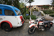 "Cuai Dai Beach. Victoria Hoi An Beach Resort & Spa. Vintage Renault ""Super Deluxe"" hotel bus and Ural sidecar motorcycle."