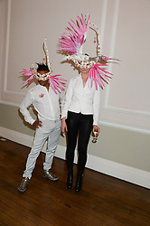 LOUIS MARIETTE and TATIANA CROFT at the The Animal Ball – Masking Up Moment held at the Quintessentially Ballrooms, 29 Portland Place, London W1 on 10th June 2013.
