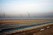Gansu, China - 26 Feb 2010. Guazhou wind farm near Yumen, Gansu province, China. China has set a target for renewable energy consumption of 40 percent of the market by the year 2050.Photographer: Markel Rendondo/Greenpeace.