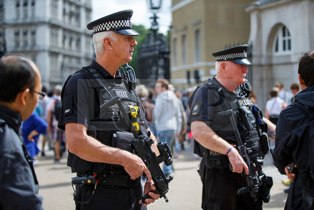© Licensed to London News Pictures. 03/08/2016. London, UK. Armed police officers patrol on Horse Guards Parade in Westminster, London on 3 August 2016. More armed police will be seen on patrol in London, Metropolitan Police commissioner Sir Bernard Hogan-Howe and Mayor of London Sadiq Khan announced. Photo credit: Tolga Akmen/LNP