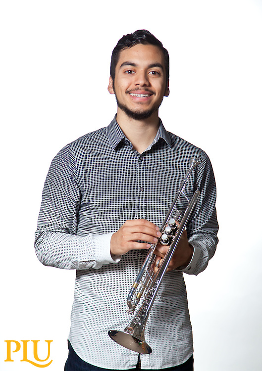 Sebastian Hernandez with his trumpet at PLU on Wednesday, March 18, 2015. (Photo: John Froschauer/PLU)