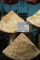 Parma, Italy --- Parmesan Cheese Wedges Hanging in a Shop Window --- Image by ? Owen Franken