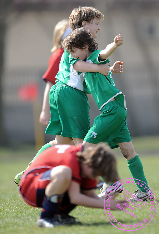 (R) KUBA GUT (UKS LADY) WITH HIS FRIEND CELEBRATE FOURTH GOAL FOR THEIR TEAM DURING SOCCER MATCH BETWEEN UKS LADY AND SEMP WARSAW AT CHILDREN'S LEAGUE (FOR BOYS BORN AT 1998 OR LATER) SEASON 2008/2009...LADY VILLAGE NEAR WARSAW , POLAND , APRIL 5, 2009..( PHOTO BY ADAM NURKIEWICZ / MEDIASPORT )..PICTURE ALSO AVAIBLE IN RAW OR TIFF FORMAT ON SPECIAL REQUEST.