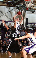 Cornell's Chris Handke (34) shoots a basket over Loras' Alex Brant (42) in the first half of their IIAC Tournament Semifinal game at Cornell College in Mount Vernon on Thursday February 26, 2009. Cornell won 65-60.