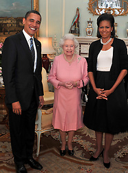 US President Barack Obama and his wife, Michelle, talk with Queen Elizabeth II during an audience at Buckingham Palace in London.