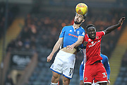 Jordan Williams wins a header during the EFL Sky Bet League 1 match between Rochdale and Walsall at Spotland, Rochdale, England on 23 December 2017. Photo by Daniel Youngs.