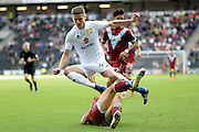 Milton Keynes Dons midfielder Ryan Colclough (49) leaps  to avoidd a tackle  during the EFL Sky Bet League 1 match between Milton Keynes Dons and Port Vale at stadium:mk, Milton Keynes, England on 9 October 2016. Photo by Dennis Goodwin.
