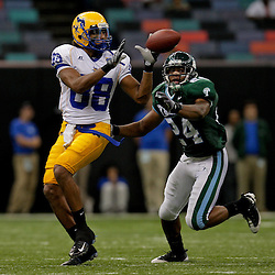 Sep 26, 2009; New Orleans, LA, USA; Tulane Green Wave safety Chinonso Echebelem (24) closes in on McNesse State Cowboys wide receiver Immanuel Friddle (88) at the Louisiana Superdome. Tulane defeated McNeese State 42-32. Mandatory Credit: Derick E. Hingle-US PRESSWIRE