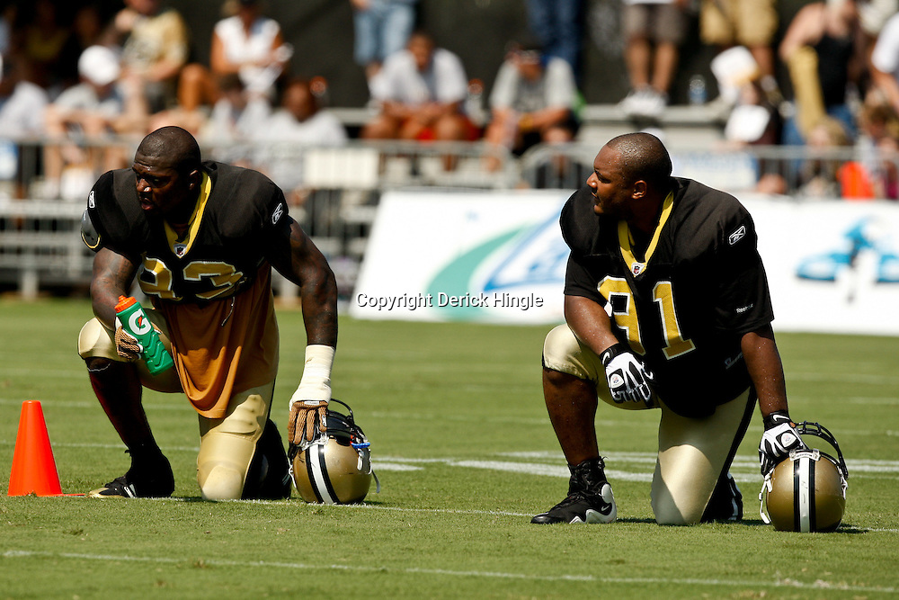 July 31, 2010; Metairie, LA, USA; New Orleans Saints defensive end Bobby McCray (93) and defensive end Will Smith (91) on the field during a training camp practice at the New Orleans Saints practice facility. Mandatory Credit: Derick E. Hingle