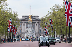 © Licensed to London News Pictures. 02/05/2015. London, UK. The Mall is decorated with Union Jack flags, as in keeping with tradition, the royal birth announcement of the Duke and Duchess of Cambridge's second child, a daughter, born at 8.34am, today, 2 May 2015, is posted on an easel outside Buckingham Palace.  The document is signed by the the delivery team at St Mary's Hospital in Paddington - led by Alan Farthing, the royal surgeon-gynaecologist . Photo credit : Stephen Chung/LNP