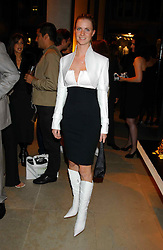 MISS CHLOE DELEVINGNE at a party to celebrate the first 20 years of fashion label Donna Karan held at her store at 19/20 New Bond Street, London W1 on 21st September 2004.<br /><br />NON EXCLUSIVE - WORLD RIGHTS