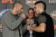 MANCHESTER, ENGLAND, NOVEMBER 12, 2009: Mike Swick (lest) and Dan Hardy face off during the pre-fight press conference for UFC 105 at the MEN Arena in Manchester, England on November 12, 2009.