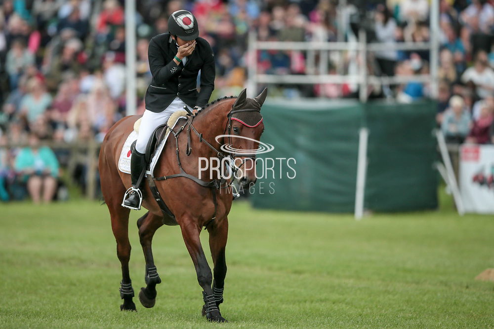 Oiwa reacts emotionally as his clear round puts him into the lead.<br /> <br /> Overall Equitrek CCI*** winner CALLE 44 ridden by Yoshiaki Oiwa (JPN) during the final show jumping round on day four of during the Bramham International Horse Trials 2017 at  at Bramham Park, Bramham, United Kingdom on 11 June 2017. Photo by Mark P Doherty.