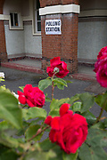 Seen through (the Labour Party symbol) red roses, is the polling station on the morning of the UK 2017 general elections outside the polling station at St. Saviour's Parish Hall in Herne Hill, Lambeth, on 8th June 2017, in London, England.