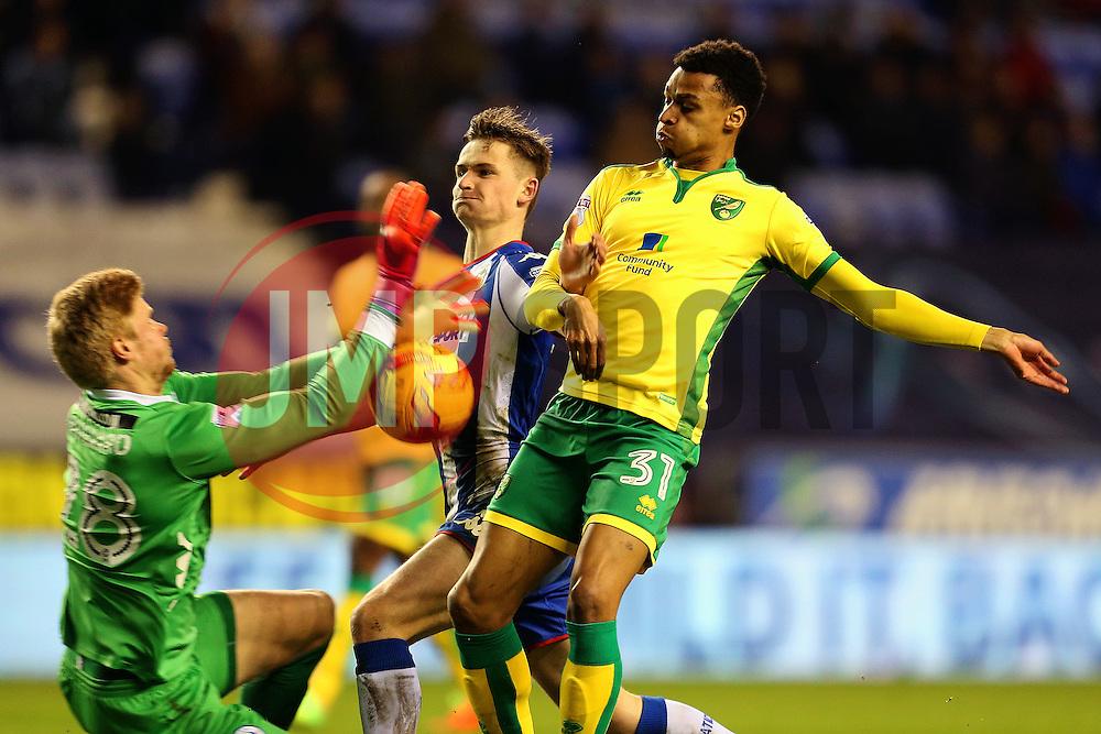 Josh Murphy of Norwich City collides with Jakob Haugaard of Wigan Athletic - Mandatory by-line: Matt McNulty/JMP - 07/02/2017 - FOOTBALL - DW Stadium - Wigan, England - Wigan Athletic v Norwich City - Sky Bet Championship