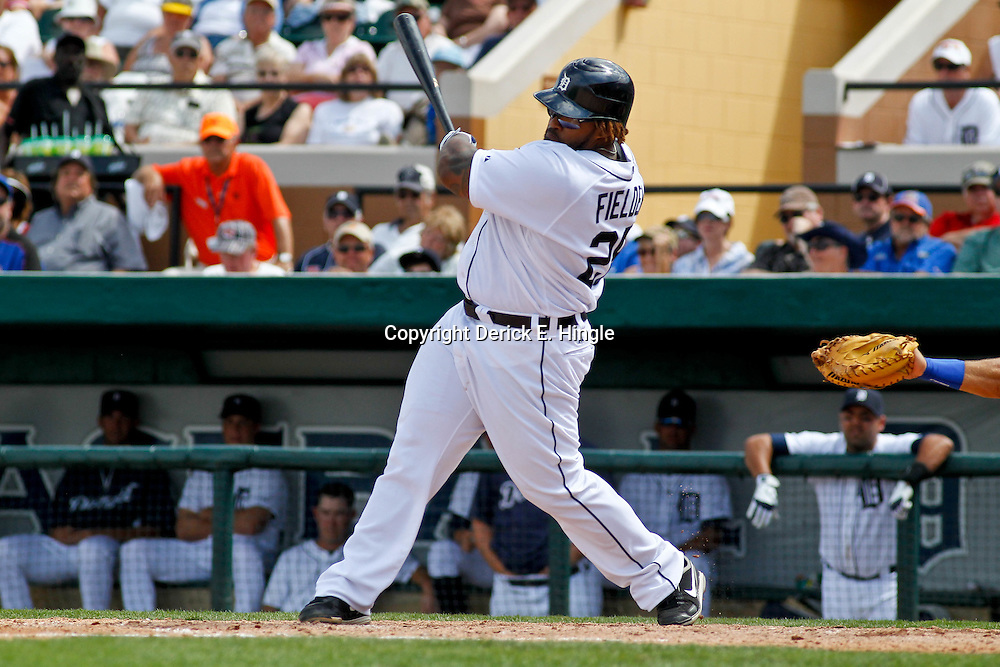March 14, 2012; Lakeland, FL, USA; Detroit Tigers first baseman Prince Fielder (28) singles during the bottom of the fifth inning of a spring training game against the New York Mets at Joker Marchant Stadium. Mandatory Credit: Derick E. Hingle-US PRESSWIRE