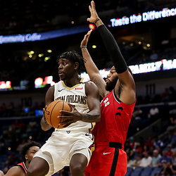 Oct 11, 2018; New Orleans, LA, USA; New Orleans Pelicans guard Jrue Holiday (11) against Toronto Raptors center Greg Monroe (15) during the second half at the Smoothie King Center. Mandatory Credit: Derick E. Hingle-USA TODAY Sports