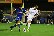 AFC Wimbledon midfielder Dean Parrett (18) and Swansea City midfielder Jay Fulton (56) during the EFL Trophy match between AFC Wimbledon and U23 Swansea City at the Cherry Red Records Stadium, Kingston, England on 30 August 2016. Photo by Stuart Butcher.