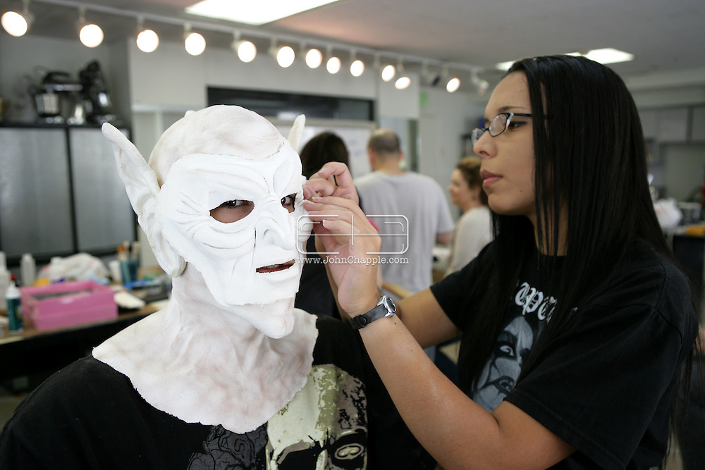 23rd October 2008, Los Angeles, California. Extreme Makeover!  Students at the Cinema Makeup School in Hollywood California, graduate from a special effects make-up course.  In this part of the course, movie industry hopefuls learn to design and create latex masks over a period of four weeks, before demonstrating their competence by transforming models into drag queens, aliens and monsters in only eight hours. Pictured is: Eddie Burke (19). PHOTO © JOHN CHAPPLE / REBEL IMAGES.john@chapple.biz    www.chapple.biz.(001) 310 570 9100.