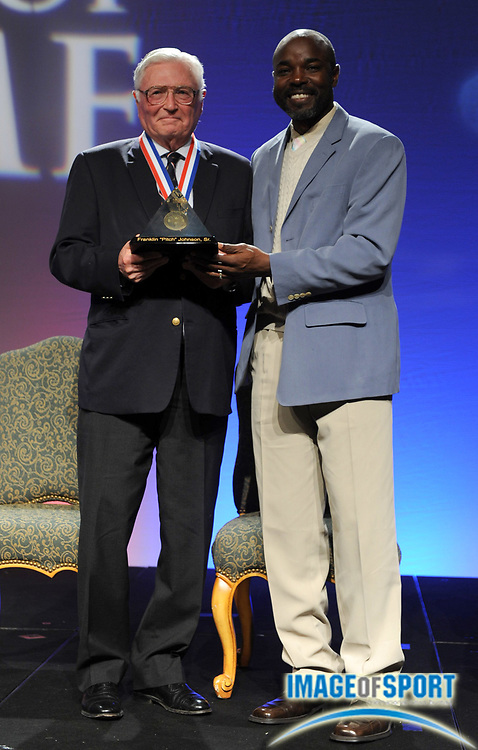Dec 16, 2009; Orlando, FL, USA; Pitch Johnson Jr. (left) and Edrick Floreal at the USTFCCCA Convention Hall of Fame induction ceremony.