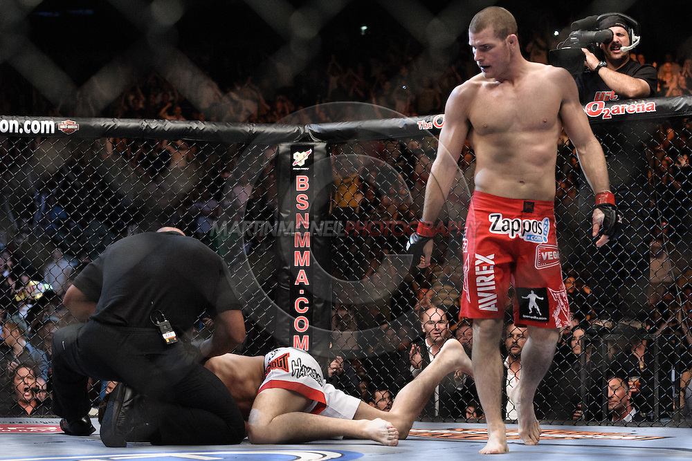 """LONDON, ENGLAND, JUNE 7, 2008: Michael Bispign (standing) walks away from a downed Jason Day, who is being checked over by referee Dan Miragliotta during """"UFC 85: Bedlam"""" inside the O2 Arena in Greenwich, London on June 7, 2008."""