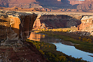 Warm sunrise colors on the canyons and Green River as seen from the White Rim Trail in Canyonlands National Park, Utah.
