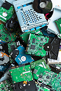 Circuit boards of computer hard drives, cables, connections and terminals plus floppy disks