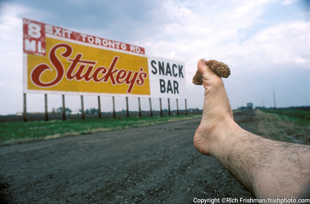 Footograph: Photograph of my right foot clutching a famous Stuckey's Pecan Log Roll between its toes.