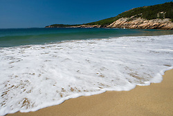 Summer surf on Sand Beach in Maine's Acadia National Park.  Mount Desert Island.