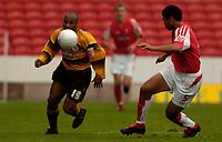 Photo: Alan Crowhurst.<br />Swindon Town v Boston Utd. The FA Cup. 05/11/2005.<br />Boston's Julian Joachim (L) takes on Jerel Ifil.