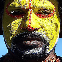 Tribesman in Traditional Face Paint Huli Wigman in Port Moresby, Papua New Guinea<br />
