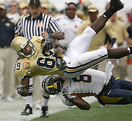 061231  JACKSONVILLE, FL:  Georgia Tech's JAMES JOHNSON,89, is tackled by  West Virginia's Quinton Andrews ,8, in the first  quarter in the Gator Bowl on  Monday, 1/1/07 in Jacksonville,FL . ©2006 Johnny Crawford