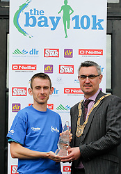 No fee for Repro:.Jason Fahy winner of the DLR Bay 10K road race in 32 minutes and 20 seconds pictured been presented with his winning prize by An Cathaoirleach Cllr Tom Joyce, Dun Laoghaire-Rathdown County Council. Pic Jason Clarke Photography