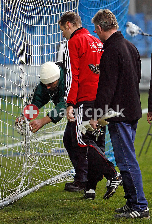 Officials repair the damage that was done by a skyrocket that has been thrown on the field of play and burnt a whole in the goal net during the game between FC Zuerich and the BSC Young Boys Bern at the Hardturm stadium in Zurich, Switzerland, Saturday, February 17, 2007. FC Zurich wins the game against BSC Young Boys Bern by one to nil. (Photo by Patrick B. Kraemer / MAGICPBK)