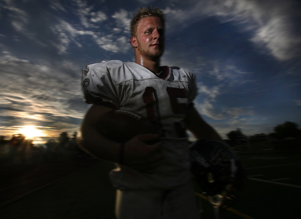 Mike Springer stands on the sideline of an Optimist All-Star practice at Cordova High School. He is one of the top backs in the Sacramento Area last season. He rushed for over 15,000 yards and helped lead Union Mine High School to the Division II championship against Grant.
