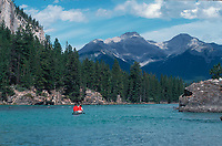 Canoeing on the Bow River near Bow Falls, Banff, Banff National Park   Photo: Peter Llewellyn