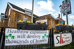 © Licensed to London News Pictures. 27/02/2020. London, UK. Reprieve for the ancient village of Harmondsworth in the borough of Hillingdon which sits 2 miles from Heathrow and was forecast to be almost demolished by the third runway as Heathrow's third runway is blocked by the Court of Appeal at the High Court on environmental grounds. Photo credit: Alex Lentati/LNP