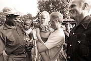 Astronaut and US senator John Glenn and his wife, Annie, visit with the Carters as the candidate began interviewing vice presidential possibilities. The couples met friend and longtime tenant farmer Leonard Wright and his daughter as they walked the Carter farmland and visited a rural Carter family cemetery.