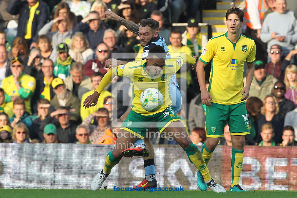 Josh Murphy of Norwich and Jon Taylor of Rotherham United during the Sky Bet Championship match at Carrow Road, Norwich<br /> Picture by Paul Chesterton/Focus Images Ltd +44 7904 640267<br /> 15/10/2016