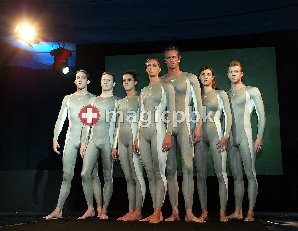 (L-R) Stephen Parry (GBR), James Hickman (GBR), Hannah Stockbauer (GER), Katy Sexton (GBR), Mark Foster (GBR), Mirna JUKIC (AUT) and Thomas Rupprath (GER) of Germany pose in the new Speedo FASTSKIN FSII (FS2) swim suit on Tuesday, March 9, 2004, at the launch party in London. (Photo by Patrick B. Kraemer/MAGICPBK)
