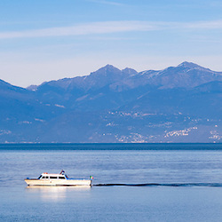 A boat passing by on Lake Maggiore, Italy