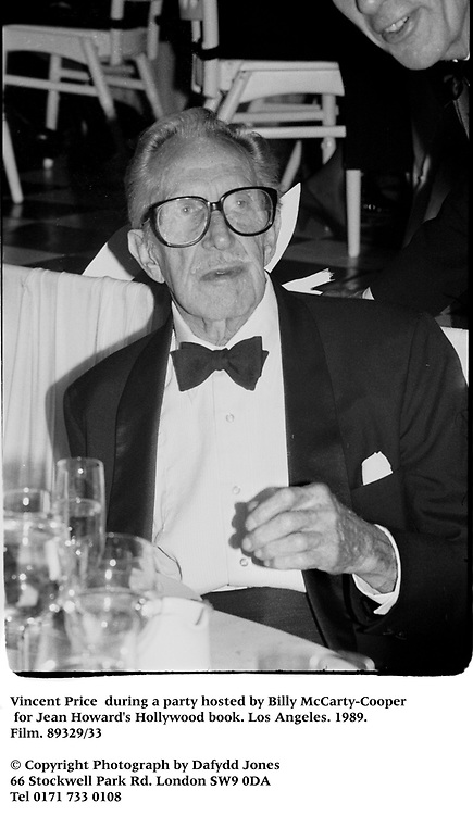 Vincent Price  during a party hosted by Billy McCarty-Cooper for Jean Howard's Hollywood book. Los Angeles. 1989. Film.89329/33<br />